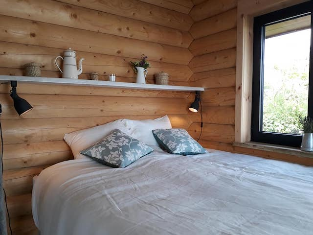 Interior picture mountain log cabin Portugal bedroom