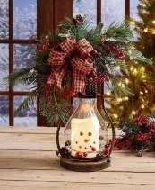 divertido-arranjo-de-natal-com-vela-imitando-boneco-de-neve-Foto-Pinterest
